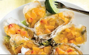 Grilled Oysters with Peach and OLD BAY® Butter
